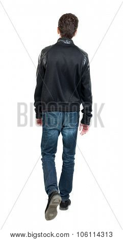 Back view of going  handsome man in jacket.  walking young guy . Rear view people collection.  backs