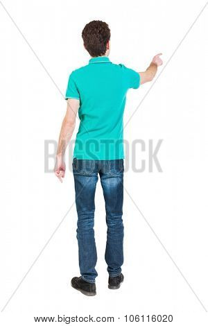 Back view of  pointing young men in  shirt and jeans. Young guy  gesture. Rear view people collectio