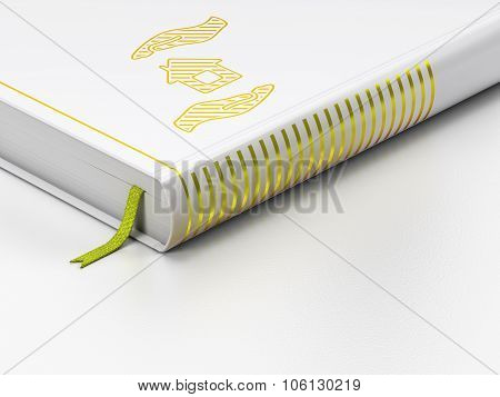 Insurance concept: closed book, House And Palm on white background