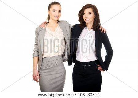 Beautiful two businesswomen embracing each other.