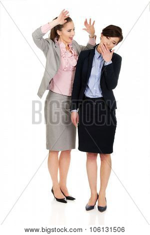 Businesswoman shouting on her yawning partner.