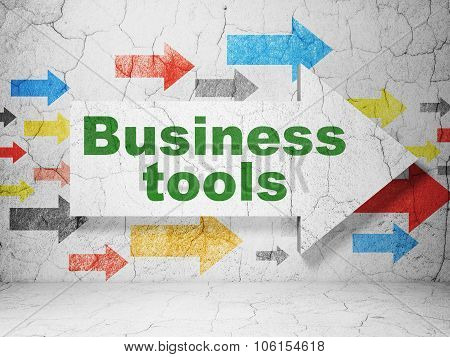 Business concept: arrow with Business Tools on grunge wall background
