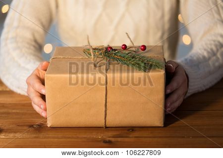 christmas, holidays, presents, new year and people concept - close up of woman with gift box or parc