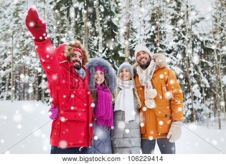 love, relationship, season, friendship and people concept - group of smiling men and women pointing