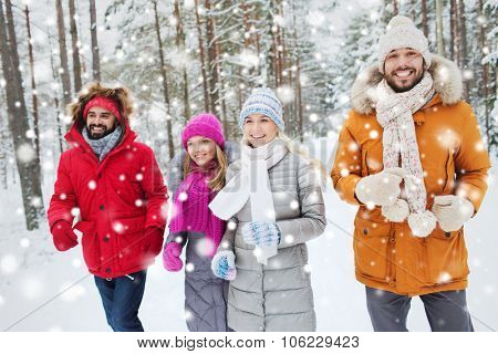 love, relationship, season, friendship and people concept - group of smiling men and women running i