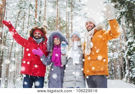 love, relationship, season, friendship and people concept - group of smiling men and women waving ha