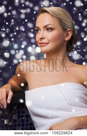 people, beauty, spa, healthy lifestyle and relaxation concept - beautiful young woman sitting in bat