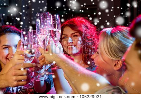 new year party, holidays, celebration, nightlife and people concept - smiling friends with glasses o