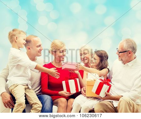 family, holidays, generation, christmas and people concept - smiling family with gift boxes sitting