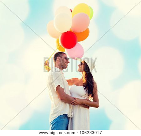 love, wedding, summer, dating and people concept - smiling couple wearing sunglasses with balloons h