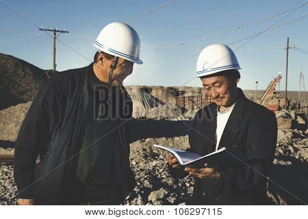 Two Construction Workers Discussing Planning Concept