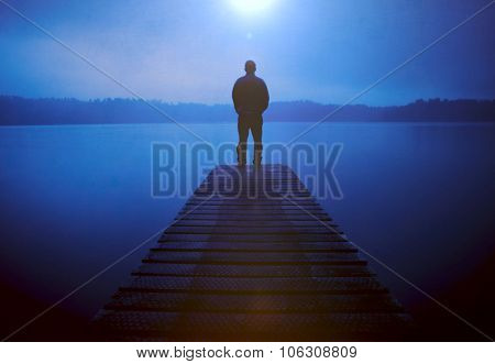 Man Standing Jetty Tranquil Lake Gloomy Fog Dusk Concept stock photo