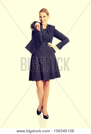 Beautiful businesswoman pointing at you