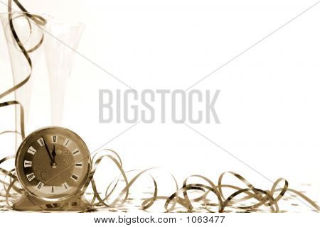 glass of champagne and streamers in sepia stock photo
