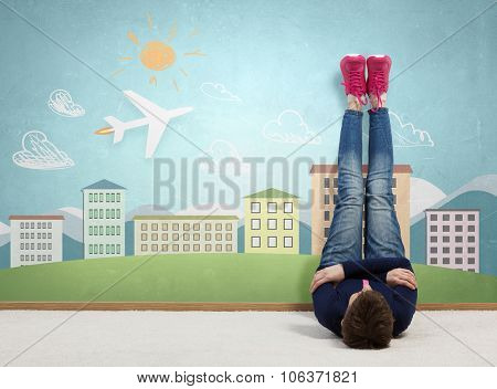 Young woman lying on floor with legs raised up