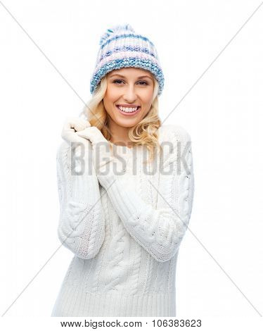 winter, fashion, christmas and people concept - smiling young woman in winter hat, sweater and glove