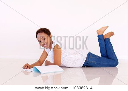 pretty young afro american college girl studying at home