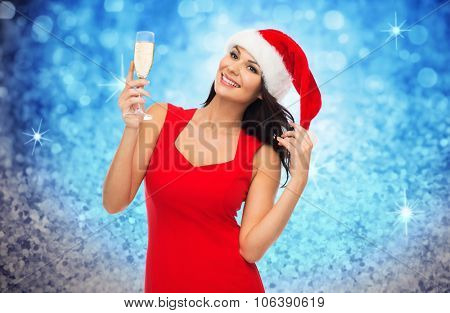 people, holidays, christmas and celebration concept - beautiful sexy woman in santa hat and red dres