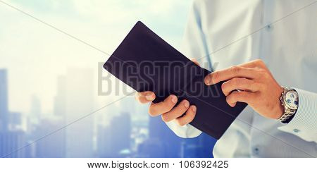 people, business, finances and money concept - close up of businessman hands holding open wallet ove