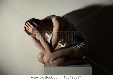 Mental illness. Image of thin girl holding her head stock photo