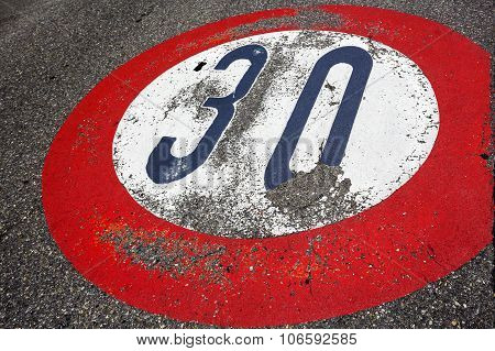 Painted on the asphalt road sign speed limit of thirty per hour stock photo