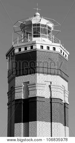 Beautiful brick lighthouse black and white shot photographed close up stock photo