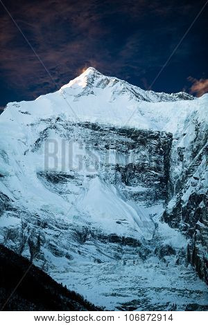 Mountain inspirational landscape in Himalayas Annapurna range Nepal. Mountain ridge with ice and snow over clear blue sunny sky. stock photo