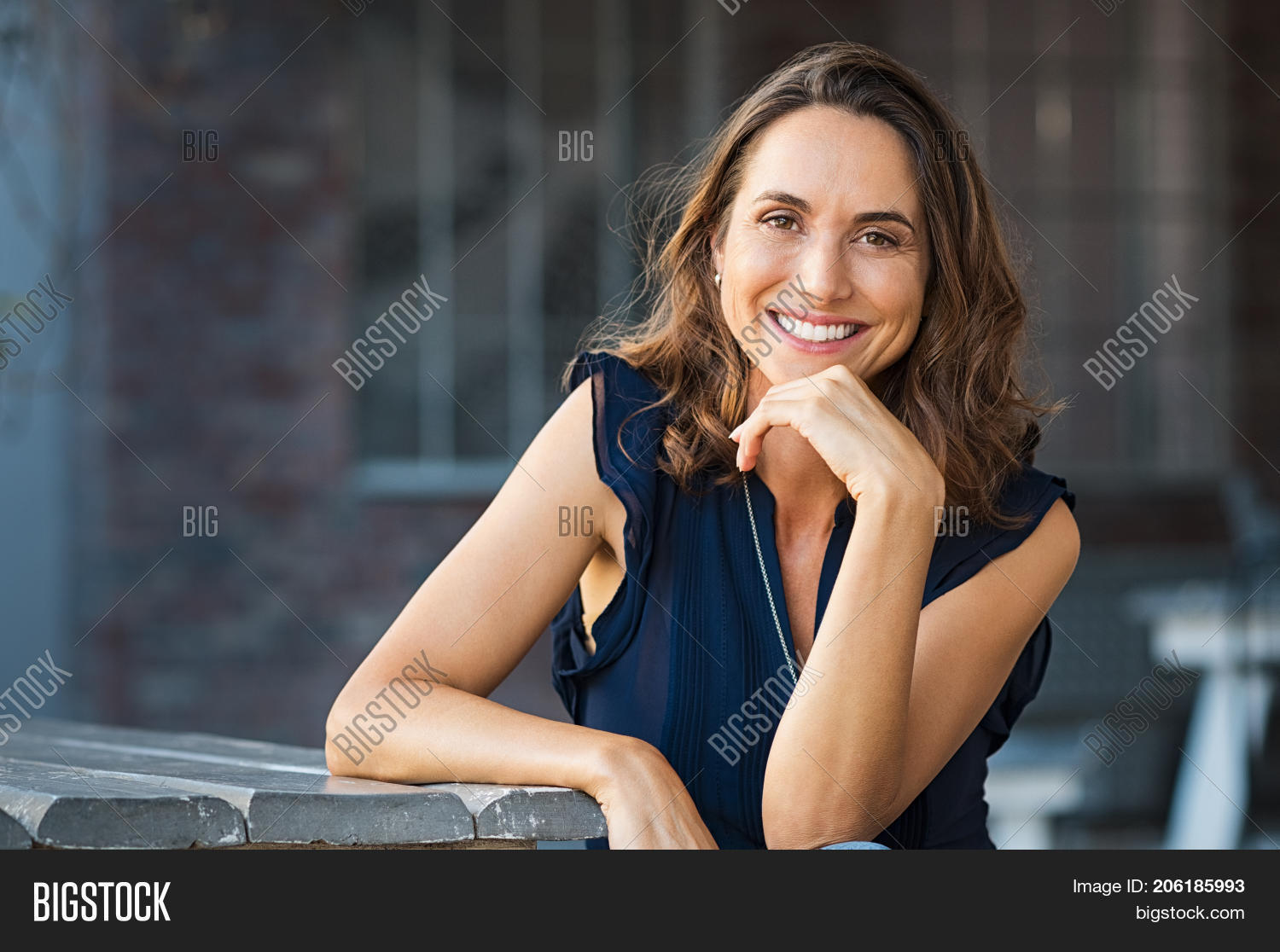 adult,attractive,beautiful,beautiful woman,brunette,brunette woman,cafeteria,carefree,carefree woman,cheerful,coffee shop,confident,enjoy,fresh,friendly,hand on chin,happy,happy woman,hispanic,hispanic woman,joy,latin,latin woman,leisure,looking,looking at camera,mature,mid,mid adult woman,outdoor,people,person,portrait,portrait woman,positive,relax,resting,satisfaction,sitting,sitting outside,smile,smiling woman,successful woman,summer,vitality,woman,woman relaxing,woman relaxing on beach