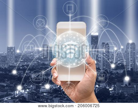 holding smart phone showing the mobile payments and online shopping with moni channel over the cityscape backgroundbusiness omni channel or multi Channel concept, 3D illustration stock photo