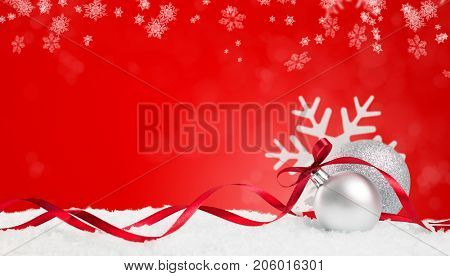 Christmas background in red. Snow flakes and christmas balls with ribbon and copyspace. Xmas background with snowflakes, balls and ribbon. Write it on whatever you need. stock photo