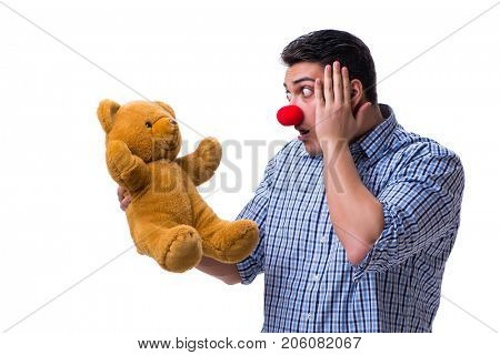 Funny clown man with a soft teddy bear toy isolated on white bac stock photo