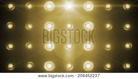 flashing shiny golden stage lights entertainment spotlight projectors in the dark gold warm soft light spotlight strike on black background stock photo