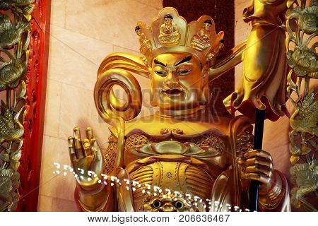 Chief of the four kings and protector of the north in Four Heavenly Kings are four Buddhist gods at Chinese temple or Wat Borom Raja Kanjanapisek (Wat Leng Nei Yee 2) in Nonthaburi Thailand stock photo