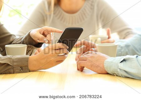 Three Friends Watching Media In A Smart Phone