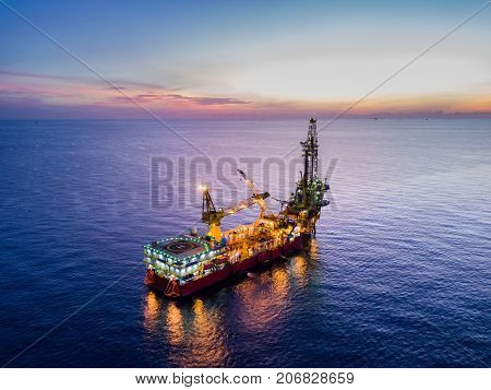 Aerial View of Tender Drilling Oil Rig (Barge Oil Rig) in The Middle of The Ocean at Surise Time stock photo