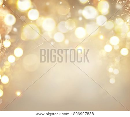 Christmas glowing Golden Background. Christmas lights. Gold Holiday New year Abstract Glitter Defocu