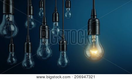 Unique, leadership, new idea concept - One light bulb lamp glowing different and standing out from o