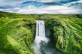 Iceland waterfall Skogafoss in Icelandic nature landscape. Famous tourist attractions and landmarks