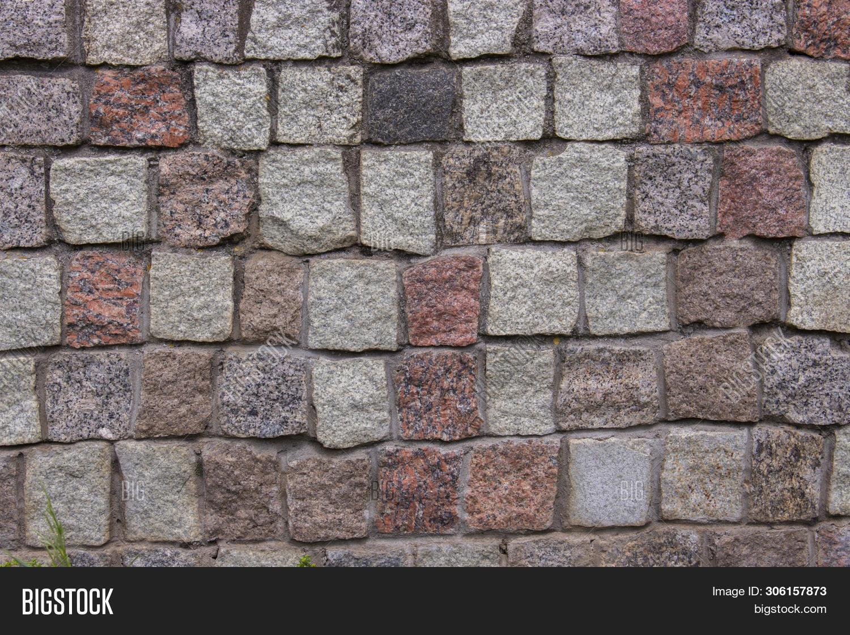 Pieces Of Cobblestones Bricks Cubes Of Granite Red Gray Pink Black, Background Texture. Granite Maso