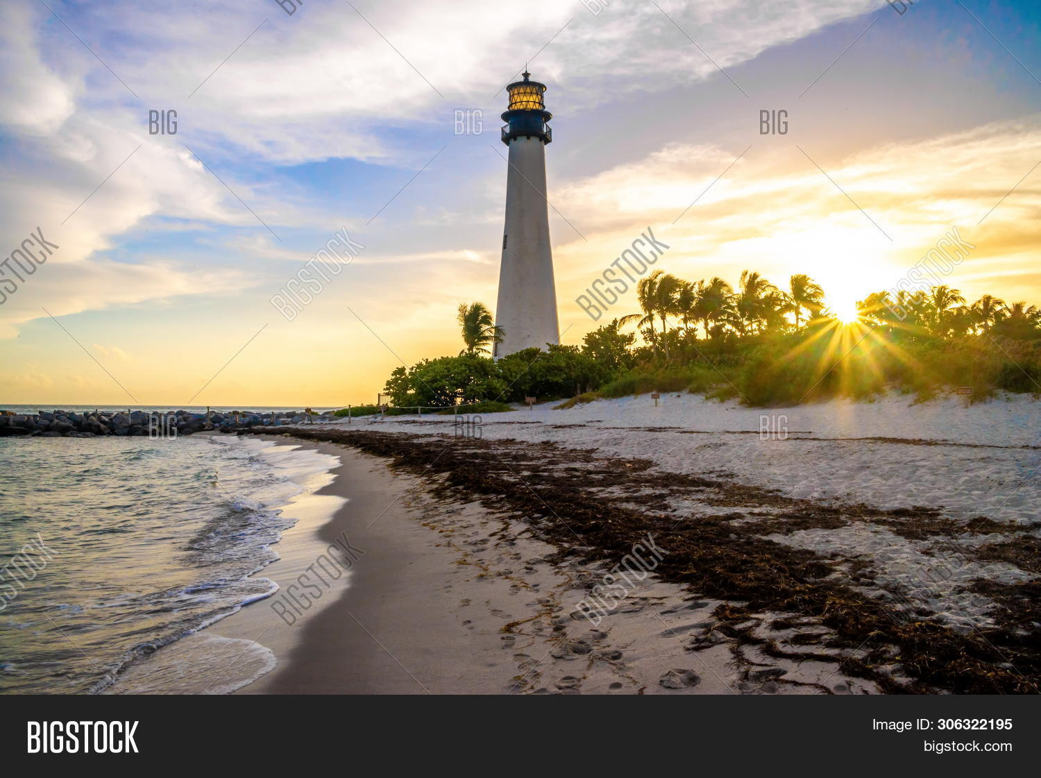 america,architecture,atlantic,beach,beacon,biscayne,blue,bright,building,cape,coast,coastline,exterior,florida,guidance,historic,historical,key,landmark,lantern,light,lighthouse,miami,navigation,ocean,old,outdoor,outside,palm,palmtree,park,sand,sandy,sea,security,sky,structure,sunset,symbol,tower,travel,tree,united,usa,vacation,white