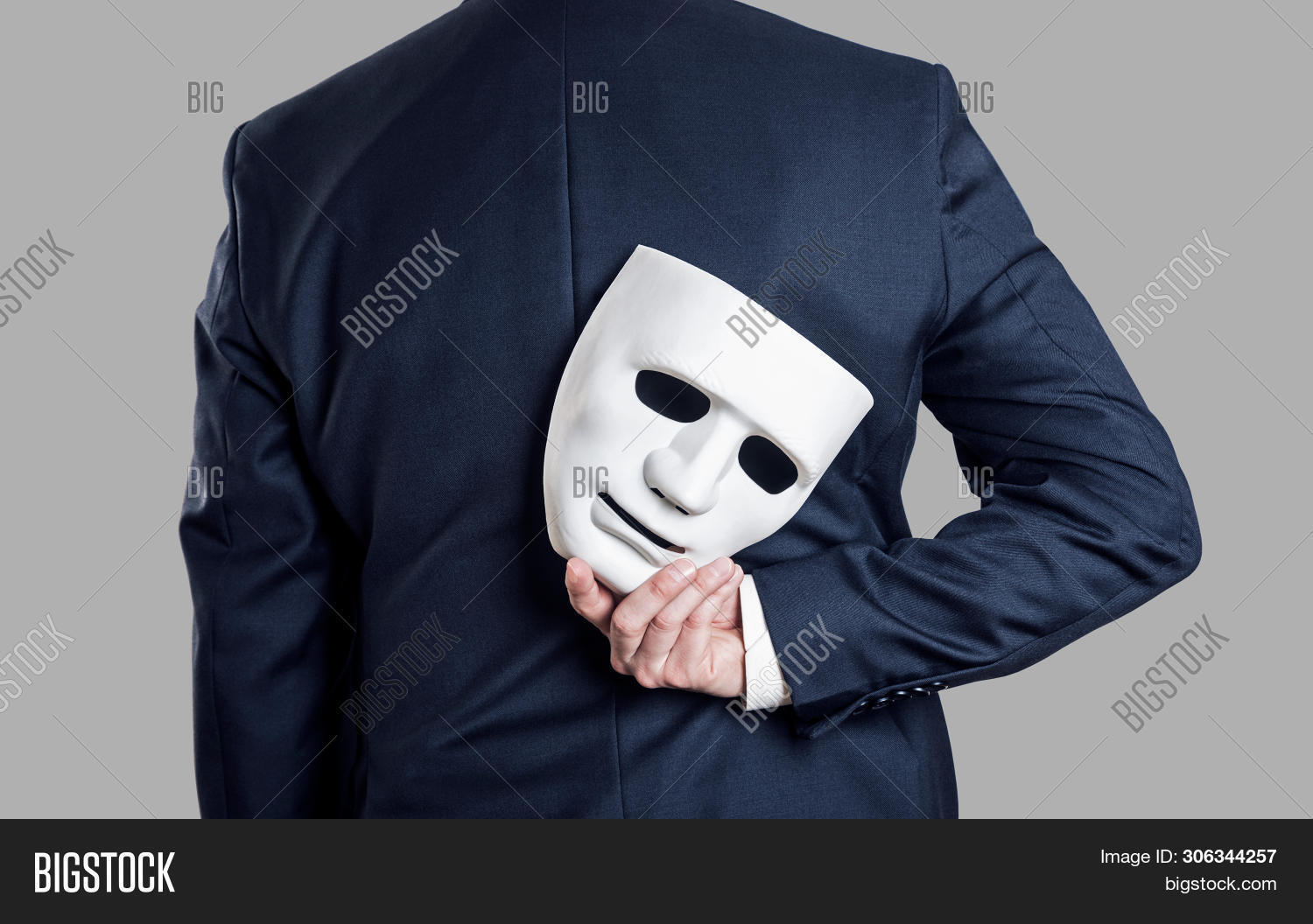 bad,bandit,betray,burglar,business,businessman,cheating,concept,crime,criminal,disguise,dishonest,double,employee,face,fake,false,fictitious,fraud,fraudster,fraudulent,guy,hacker,hide,holding,hypocrite,immoral,impostor,isolated,lie,male,man,mask,partner,partnership,people,person,robber,secret,sham,spy,suit,thief,tricky,unethical,unfair,untrue,white,young