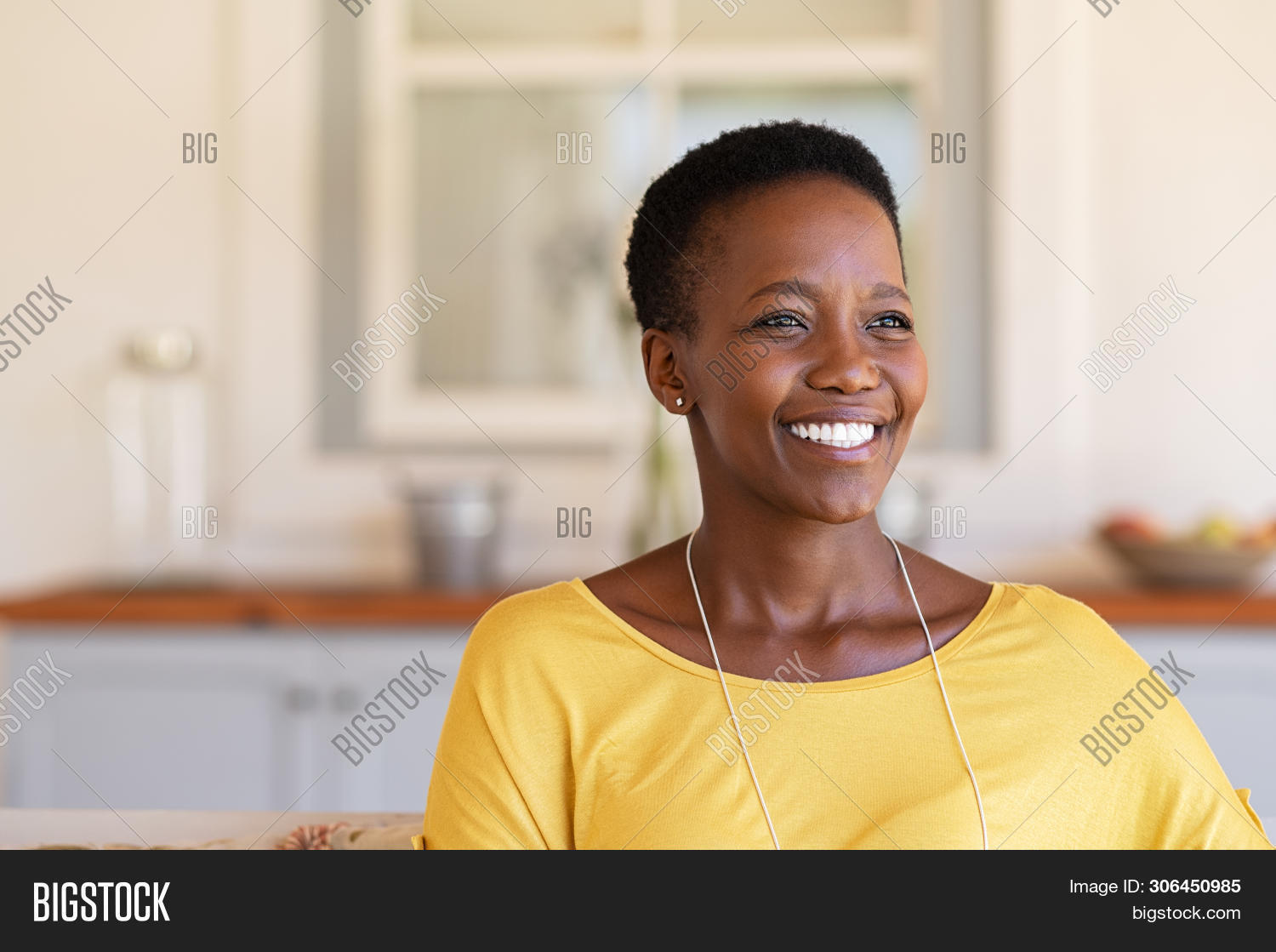 african,african american,african woman,afro,american,aspiration,beautiful,beautiful woman,black,care,carefree,casual,cheerful,confidence,confident,copy space,couch,daydreaming,enjoy,expression,freedom,future,happiness,happy,healthy,home,hope,imagination,joy,lifestyle,looking away,mature,mid adult woman,middle aged woman,patio garden,people,portrait,pretty,real,real people,relax,relaxing at home,satisfaction,satisfied,sitting,smile,sofa,toothy smile,vision,young