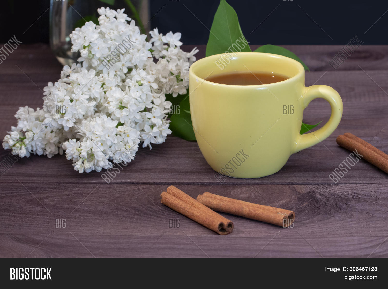 baked,branch,breakfast,brown,chinese,cinnamon,cup,dark,decorated,delicious,dessert,drink,eating,flowers,food,fresh,home,lilac,nobody,party,pleasant,service,spring,sticks,sweet,table,tea,white,wooden,yellow