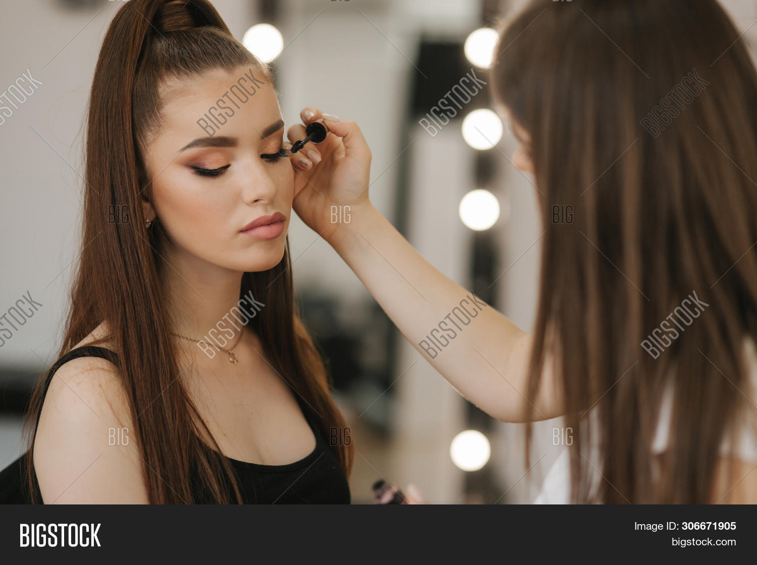 Makeup Artist Work In Her Beauty Studio. Woman Applying By Professional Make Up Master. Beautiful Ma