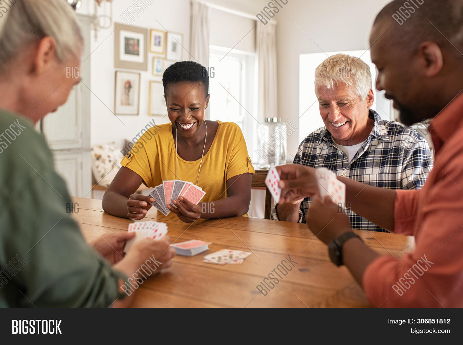 active,active seniors,african,aged,black,card,cheerful,couple,couples,elderly,enjoy,entertainment,friend,friends,friends playing cards,friendship,fun,game,glad,group,happy,home,indoors,leisure,man,mature,mid adult man,mid adult woman,multi ethnic group,multiethnic,old man,people,play,playing cards,playing together,retired,retirement,senior,senior man,senior woman,seniors,sitting,smile,social,strategy,table,talking,together,toothy smile,woman