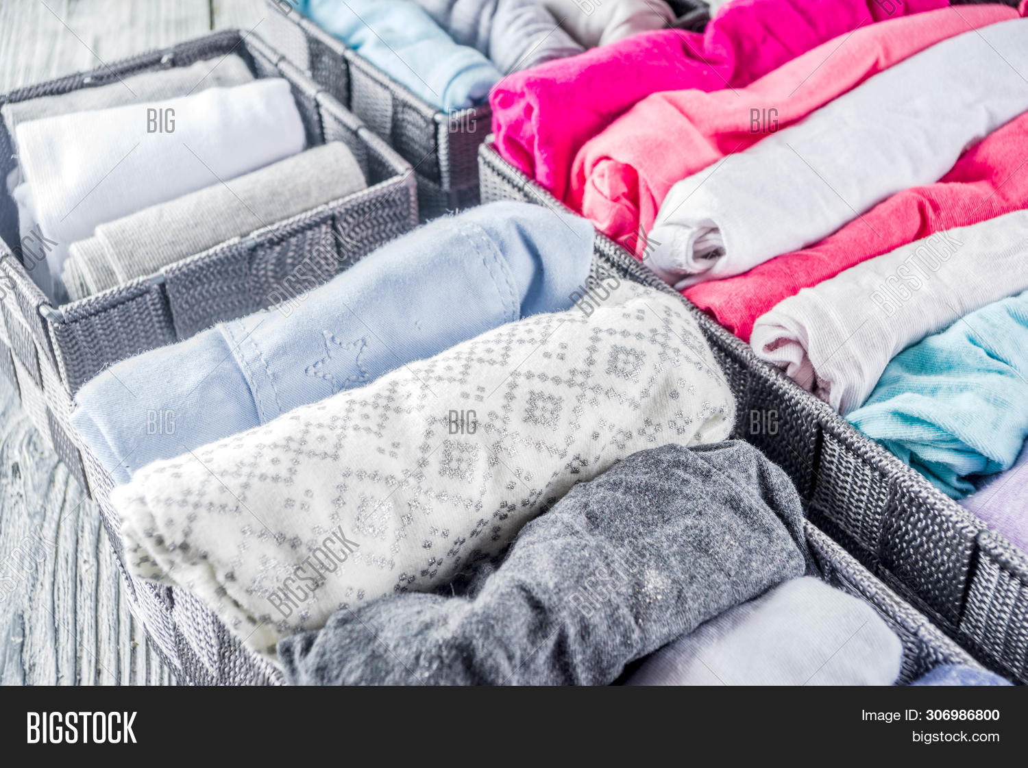 House,Kondo,Marie,Vertical,above,background,box,clean,cleaning,closet,clothes,clothing,color,dresser,fashion,female,fly,folded,folding,home,indoor,interior,konmari,konmary,lady,light,linen,maintaining,mary,method,minimal,order,organizer,overhead,pattern,room,shirt,socks,storage,style,textile,tiding,tidying,tidyng,top,underwear,view,wardrobe,white