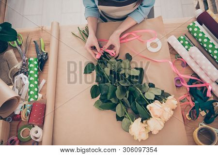 Top above high angle cropped view photo of small business representative youth hold hand good-looking trendy stylish shirt art show occupation table paper orangery stock photo