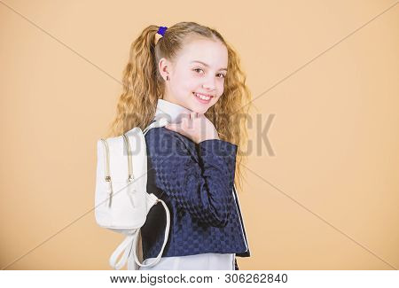 Stylish mini backpack. Learn how fit backpack correctly. Girl little fashionable cutie carry backpack. Schoolgirl with small leather backpack. Carry bag comfortable. Popular useful fashion accessory stock photo
