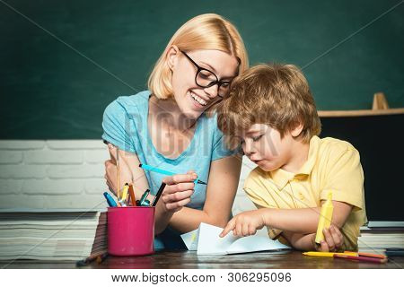Back To School And Happy Time. Happy School Kids. Education And Learning People Concept. Teacher And