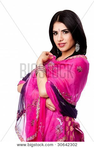 Beautiful Bengali Indian Hindu woman in colorful dress standing isolated stock photo